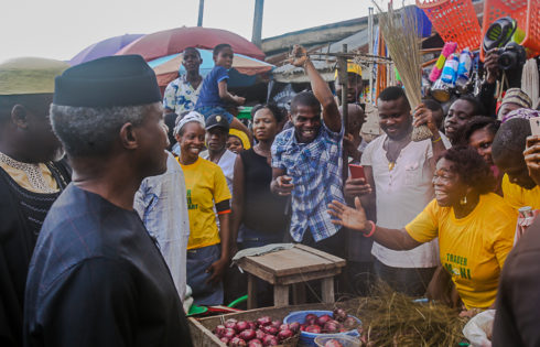 VP Osinbajo interacts with beneficiaries of the trader moni program.