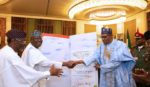 PRESIDENT BUHARI RECEIVES 77TH BIRTHDAY CARD FROM PRESIDENT OF SENATE AND SPEAKER